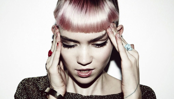 Grimes cancels gigs due to hearing loss