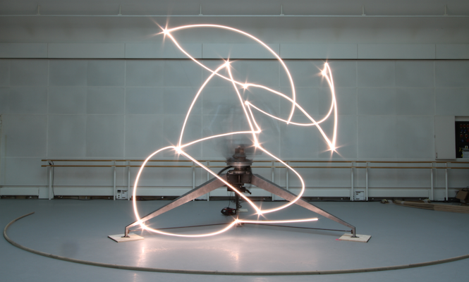 Holly Herndon and Mira Calix collaborating with artist Conrad Shawcross on robot installation