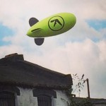An Aphex Twin blimp is flying over London