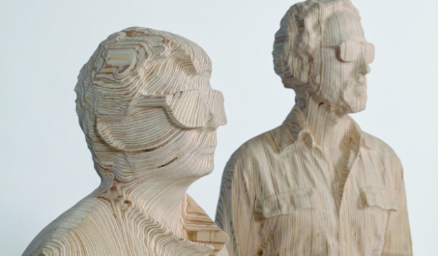 Daft Punk unmasked in intricate wooden sculptures