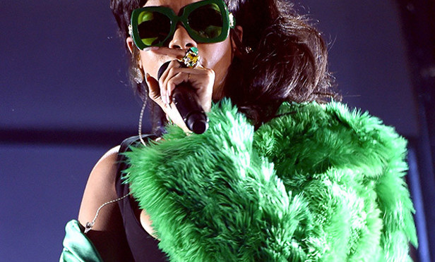 Watch Rihanna perform her new single 'Bitch Better Have My Money' dressed as The Riddler