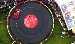 Watch a giant vinyl get played by a car
