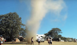 Watch a crowd of fearless Aussie ravers dance inside a tornado