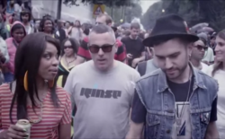A-Trak, DJ Zinc, and Natalie Storm party at Carnival in the 'Like the Dancefloor' video