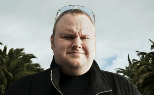 Kim Dotcom launches MEGA by staging fake FBI raid; service claims 250,000 registrations in first two hours
