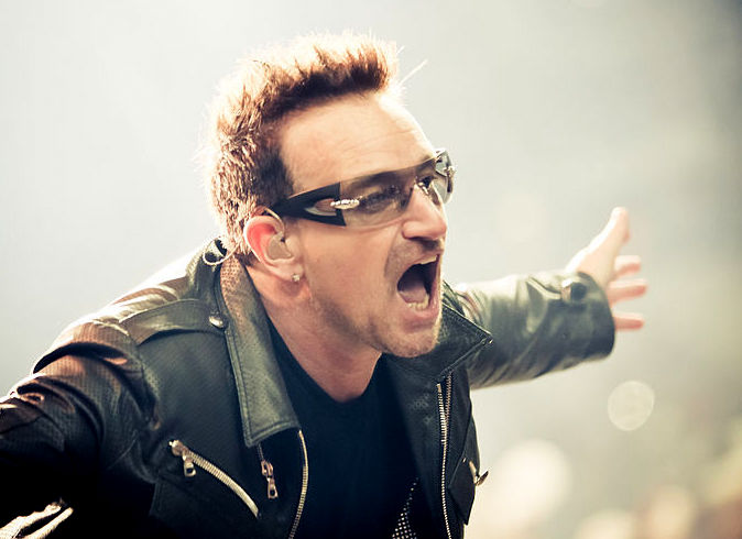 """Oops. I'm sorry about that."" Bono apologizes for U2's <em>Songs of Innocence</em> release"