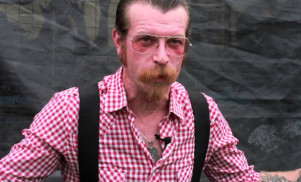 "Eagles Of Death Metal's Jesse Hughes apologizes for ""baseless"" conspiracy remarks"