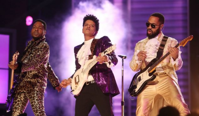 Bruno Mars honors Prince with guitar-shredding Grammys performance of 'Let's Go Crazy' –watch