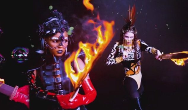 Grimes and Janelle Monáe wield flaming swords in epic 'Venus Fly' video