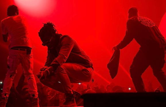 Travis Scott fell down a massive hole onstage with Drake last night and the internet lost its shit