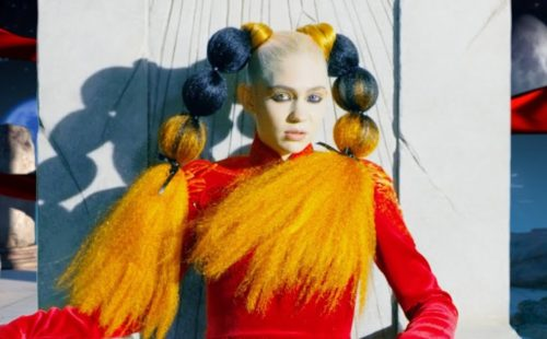 Grimes sits atop a crumbled empire in new 'Delete Forever' video